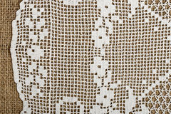 Doily on burlap Royalty Free Stock Photography