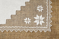 Doily on burlap Stock Images