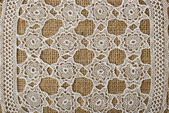 Doily on burlap Royalty Free Stock Photos