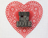 Doily heart with love words Stock Photo