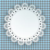Doily on a plaid background Royalty Free Stock Images