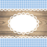 Doily on rustic wooden texture with empty lace frame Stock Images