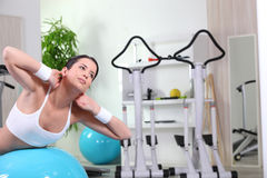 Doing abdominal exercises in the gym Stock Photo