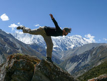 Doing arabesque with view to Tilicho, Nepal Royalty Free Stock Images