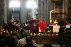 Doing botafumeiro. Priests are doing the botafumeiro a big silver incense burner inside the holy cathedral of santiago de compostela in spain Stock Images