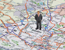 Doing Business in Atlanta. Business man figure standing on a map of Atlanta Georgia, USA Stock Photos