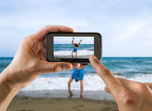 Doing cartwheel Royalty Free Stock Image