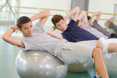 Doing crunch on ball. Doing crunch on the ball Royalty Free Stock Images