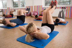 Free Doing Crunches On Floor Mat Stock Photos - 53859273