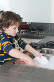 Doing the dishes stock photos