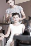 Doing elegant hairstyle Stock Photos