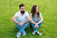 Doing everything together. summer relax in park. cute girl and bearded man hipster on green grass. romantic couple. Doing everything together. summer relax in stock photo