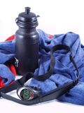 Doing exercise... Towel, bottle an a heart monitor watch royalty free stock image