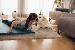 Doing exercise with my lazy dog Stock Image