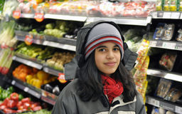 Latin teenager girl doing groceries Royalty Free Stock Images