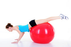 Doing gymnastics with fitball Royalty Free Stock Images