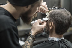 Doing haircut in barbershop Royalty Free Stock Images