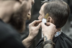 Doing haircut in barbershop Royalty Free Stock Photo