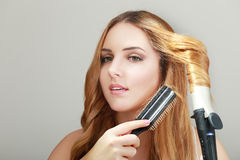 Doing hairstyle at home Royalty Free Stock Photo