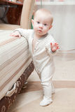 She is doing her first steps. Royalty Free Stock Photography
