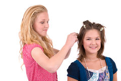 Doing her hair Royalty Free Stock Photography