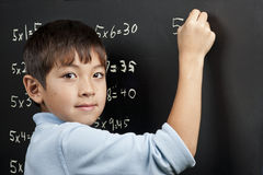 Doing his multiplication. Stock Photo