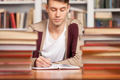 Doing his research in library. Stock Images