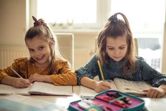 Doing homework is better when we do it together stock photography