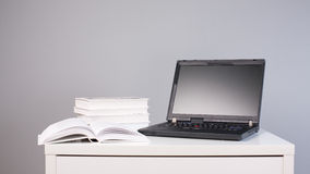 Doing homework - desk with books and laptop Stock Image
