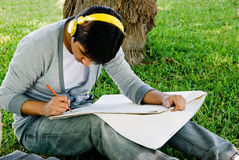 Doing homework outdoor Stock Photos
