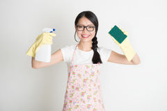 Doing house chores Stock Photos