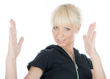Doing karate. Beautiful blondy doing karate with hands stock photos