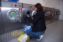 Doing the Laundry. Young Woman doing the Laundry Royalty Free Stock Photo