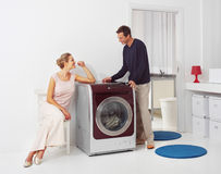 Doing laundry at home Stock Photos