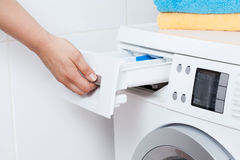 Doing the laundry. Horizontal view of doing the laundry in bathroom Stock Photo
