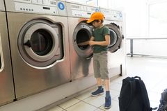 Doing the laundry in a laundromat salon Royalty Free Stock Images