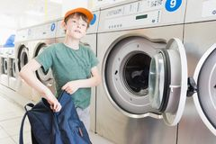 Doing the laundry in a laundromat salon Royalty Free Stock Photography