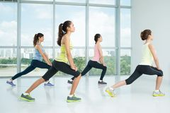 Doing lunges Stock Photo