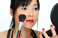 Doing make-up Royalty Free Stock Photos