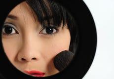 Doing make-up Royalty Free Stock Image