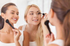 Doing make-up together. Royalty Free Stock Images