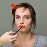doing makeup Stock Photos