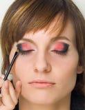 Doing makeup Royalty Free Stock Photos