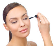 Doing Makeup Royalty Free Stock Images