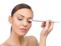 Doing Makeup Stock Images