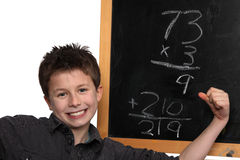 Doing the math. Young boy cheering over his math success Stock Photo