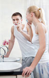 Doing morning procedures couple is in the bathroom Stock Photography