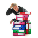 Doing paper administration. Elderly man in panic while having lots of paper administration royalty free stock photography