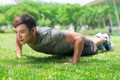 Doing push-ups Stock Photos