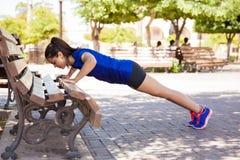 Doing push ups at a park Royalty Free Stock Photo